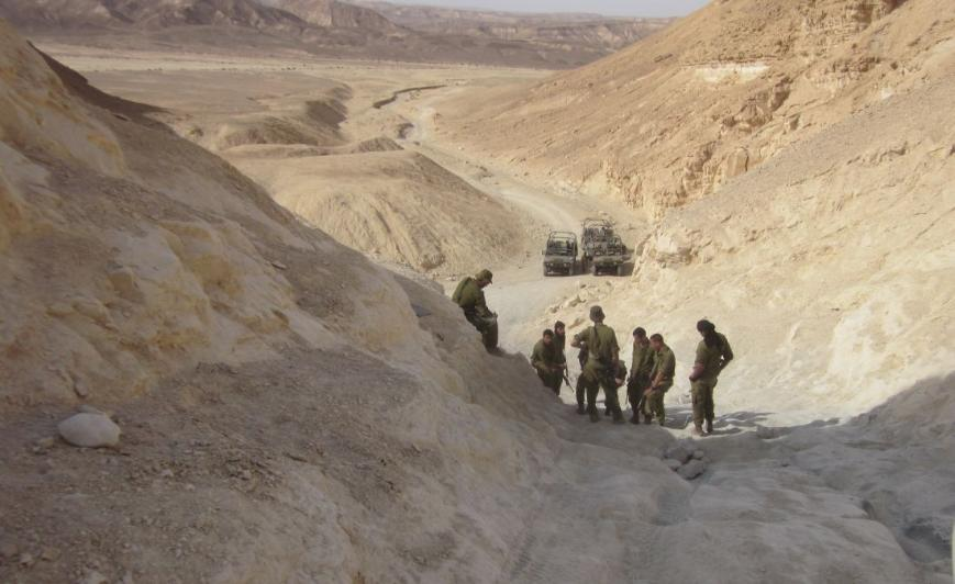 Soldiers practicing driving up and down a steep difficult incline