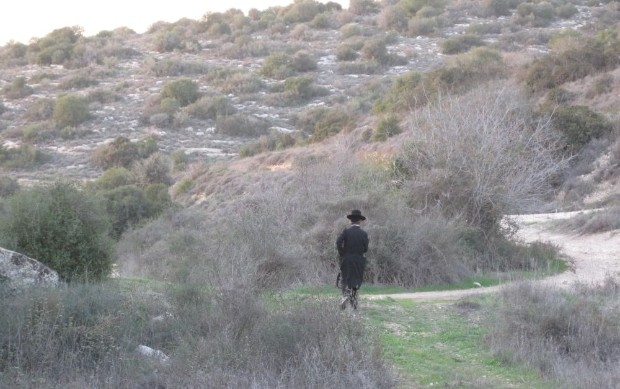 Ultra Orthodox man hiking past us.