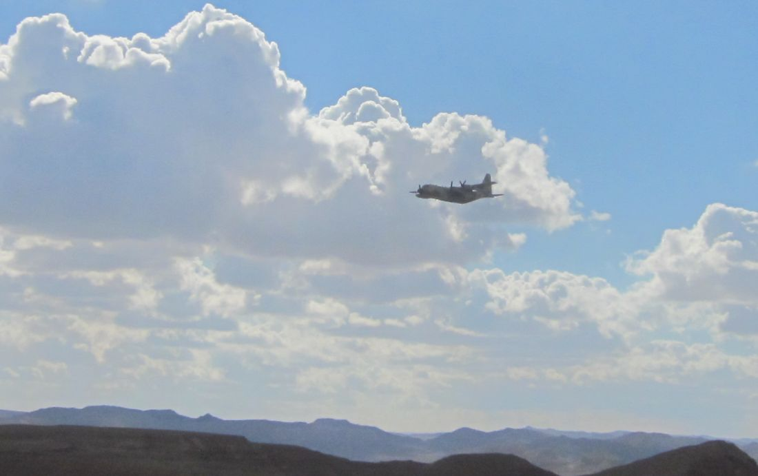 Hercules transport plane flying by.