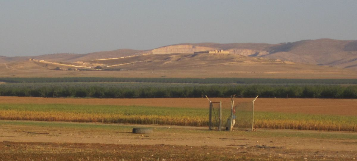 Tel Arad with the huge quarry in the background