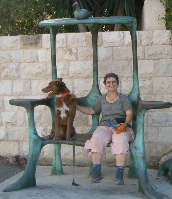 Diana and Taffy in Ein Hod sitting on sculpture bench