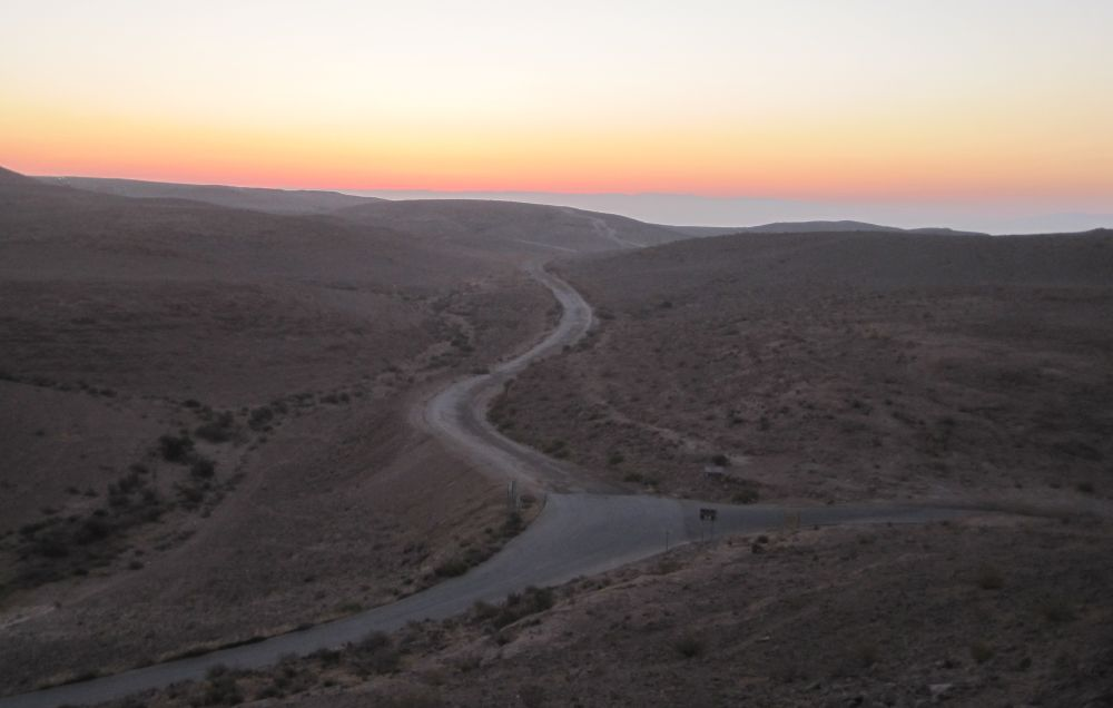 Sun rise over the junction between the access road to Machtesh HaKatan and Route 227 just about to start down the scorpian ascent  (מעלה עקרבים )