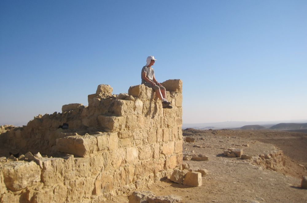 Diana sitting on a wall of the ruin of the Roman outpost Meizad Zafir ( מצד צפיר ),