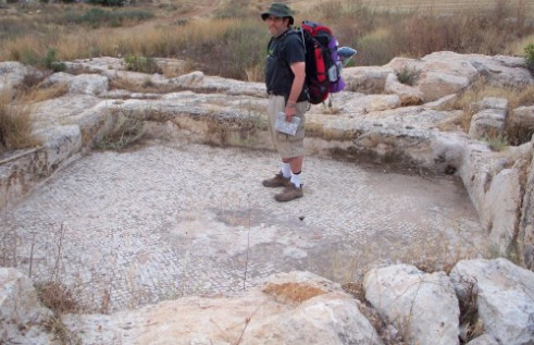 Don standing on a mosaic at Nevallat ruins near Rt. 6