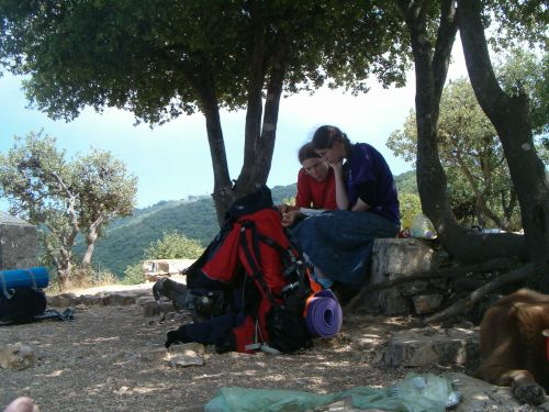 Two dati girls who were hiking the whole Israel trail - praying after eating.