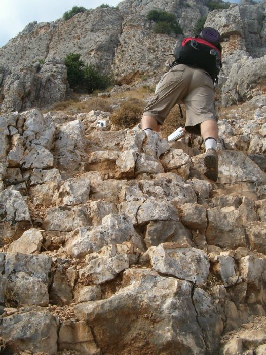 Don climbing up Arbel Cliff