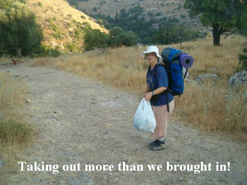 Diana taking our trash from the trail