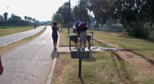 Yarkon Park in Tel Aviv, drinking fountain and joggers